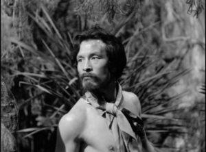 Kusatabe (Tadashi Suganuma) becomes jealous of the attention paid to Keiko (Akemi Negishi) by the sailors in Josef Von Sternerg's The Saga of Anatahan (1953)