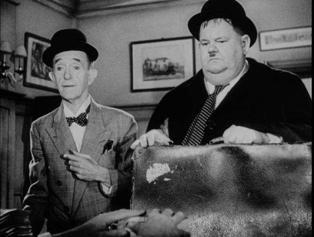 Stan and Ollie receive bad news at the lawyer's office in Leo Joannon's Atoll K (1951)