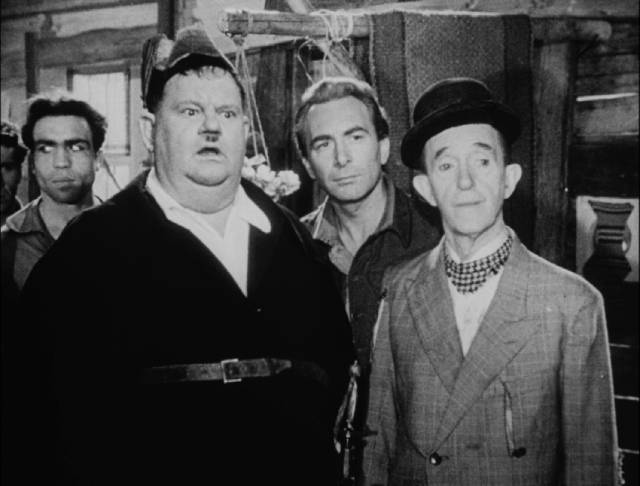 Stan and Ollie find themselves accused of treason on their own island in Leo Joannon's Atoll K (1951)