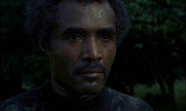 Calvin Lockhart as big game hunter Tom Newcliffe aims to bag a werewolf in Paul Annett's The Beast Must Die (1974)