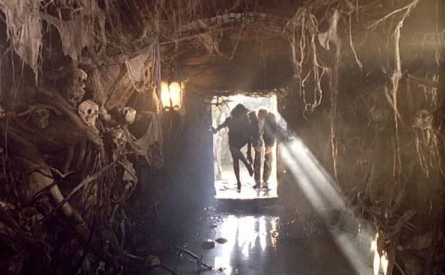 Cemetery caretaker Dellamorte (Rupert Everett) gives a tour of the ossuary in Michele Soavi's Dellamorte Dellamore (1994)