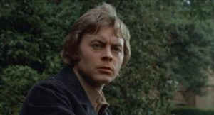 Working class Michael Rogers (Hywel Bennett) fantasizes about a life of privilege in Sidney Gilliat's Endless Night (1972)
