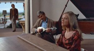 The dying Santonix (Per Oscarsson) enjoys a musical interlude with Ellie (Hayley Mills) in Sidney Gilliat's Endless Night (1972)