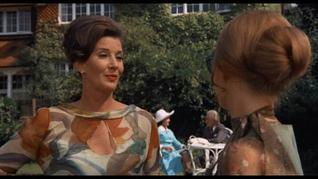 A prickly moment between Ellie's stepmother (Lois Maxwell) and Greta (Britt Ekland) at a garden party in Sidney Gilliat's Endless Night (1972)