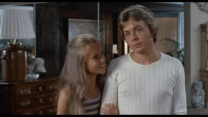 Michael (Hywel Bennett) can't avoid the distrust, even contempt, of Ellie (Hayley Mills)'s relatives in Sidney Gilliat's Endless Night (1972)