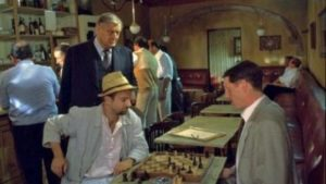 Maigret has villagers re-stage their activities at the time of the crime in The Candle Auction (1994)