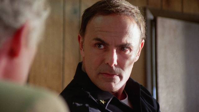John Saxon as bad cop Strycher in Umberto Lenzi's Nightmare Beach (1989)