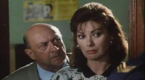 Inspector Datti (Donald Pleasence) is concerned about the safety of Helene Martell (Edwige Fenech) in Ruggero Deodato's Phantom of Death (1988)