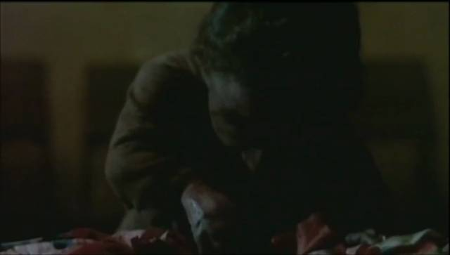 Ratman (Nelson de la Rosa) helps himself to a midnight snack in Giuliano Carnimeo's Ratman (1988)