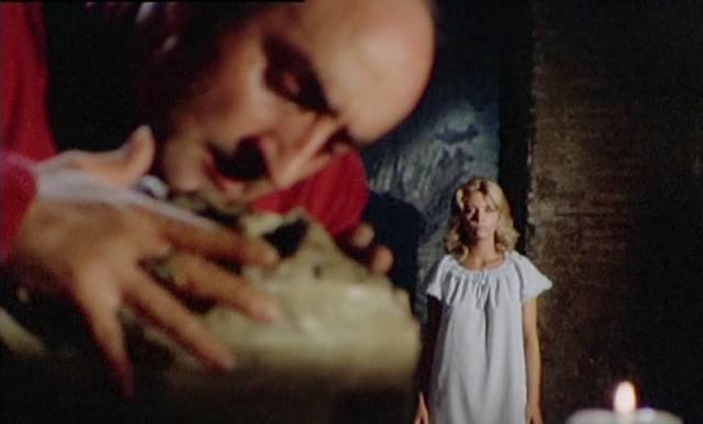 Family retainer Isidro (Giuseppe Carbone) plays with the contents of the crypt in Mario Bianchi's Satan's Baby Doll (1982)