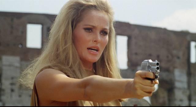 Hunter Caroline Meredith (Ursula Andress) stalks her prey in Elio Petri's The 19th Victim (1965)