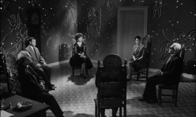 Seer Peter Cornelius (Wolfgang Preiss) conducts a seance in Fritz Lang's The Thousand Eyes of Dr. Mabuse (1960)