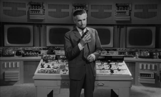 Psychiatrist Dr. S. Jordan (Wolfgang Preiss) in the Hotel Luzor's control centre in Fritz Lang's The Thousand Eyes of Dr. Mabuse (1960)