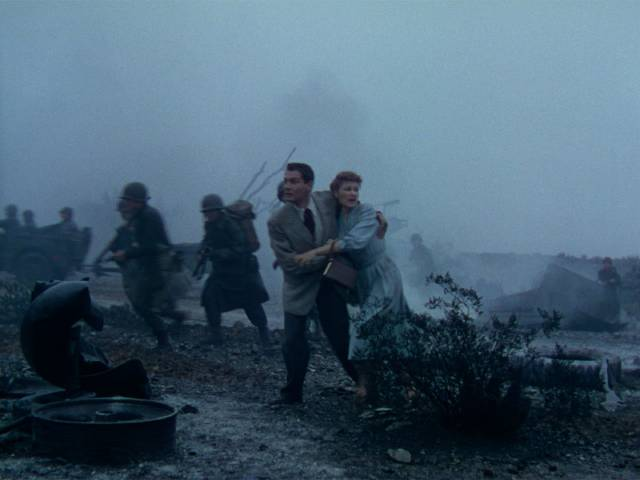 Dr. Clayton Forrester (Gene Barry) and Sylvia Van Buren (Ann Robinson) flee the initial military engagement in Byron Haskin's The War of the Worlds (1953)