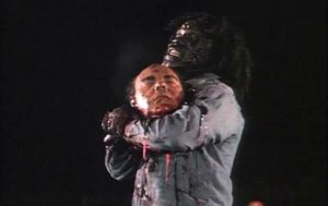 An infected prisoner shows his strength in John Saxon's Death House (1988)