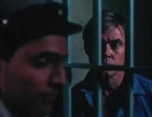 Dennis Cole as wrongfully convicted Derek Keillor in John Saxon's Death House (1988)