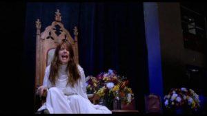 Medium Martha Travis (Rosanna Arquette) is terrified by her own visions in Mike Hodges' Black Rainbow (1989)