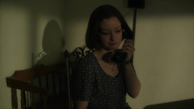 Lois (Jodi Lynn Thomas) begins to understand how dangerous Art (Josh Phillips) is in Pete Schuermann's The Creep Behind the Camera (2014)