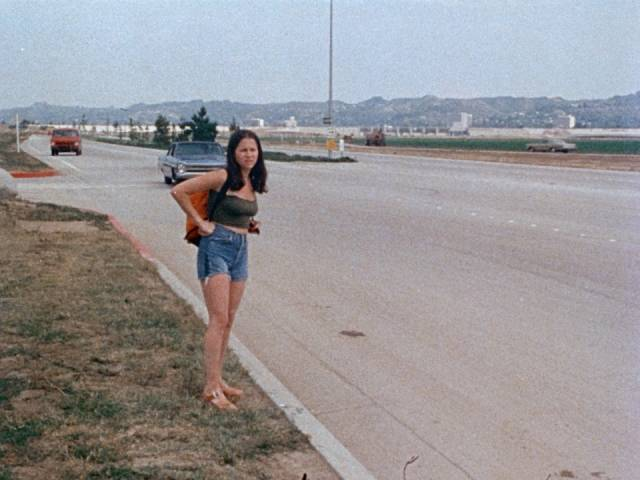 A runaway is unaware that danger is approaching in Irvin Berwick's Hitch Hike to Hell (1977)