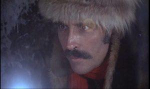 Arrogant gentleman scientist Sir Alexander Saxton (Christopher Lee) discovers a dangerous artefact in Eugenio Martin's Horror Express (1972)