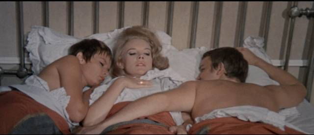 Carroll Baker is seduced by brother and sister Lou Castel and Colette Descombes in Umberto Lenzi's Orgasmo (1969)