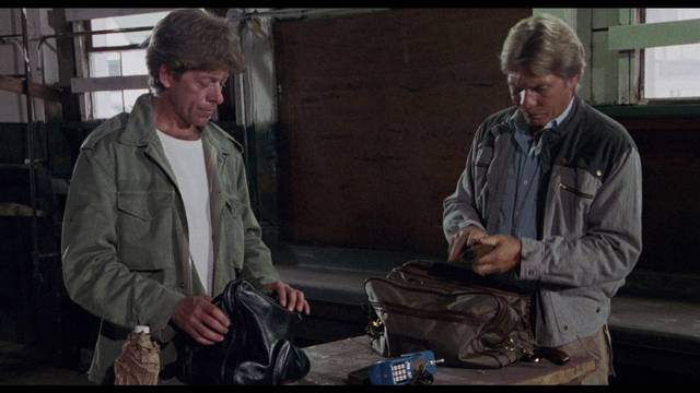 The vets assemble an arsenal to fight gangs in the neighbourhood in Charles E. Sellier Jr's The Annihilators (1985)