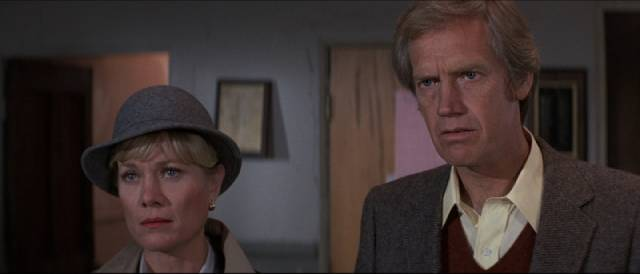 Dad Eli (Ronny Cox) and Mom Caroline (Bibi Besch) search for answers to their son's condition in Philippe Mora's The Beast Within (1981)