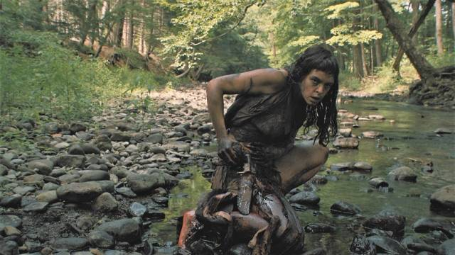 The woman cleans her wounds in a stream in Lucky McKee's The Woman (2011)