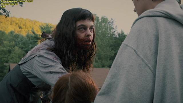 The Woman (Pollyanna McIntosh) offers Chris Cleek (Sean Bridgers)' daughters an unexpected form of liberation in Lucky McKee's The Woman (2011)
