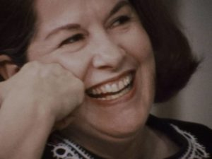 Head of the New York chapter of NOW, Jacqueline Cebellos is amused in Chris Hegedus and D.A. Pennebaker's Town Bloody Hall (1979)