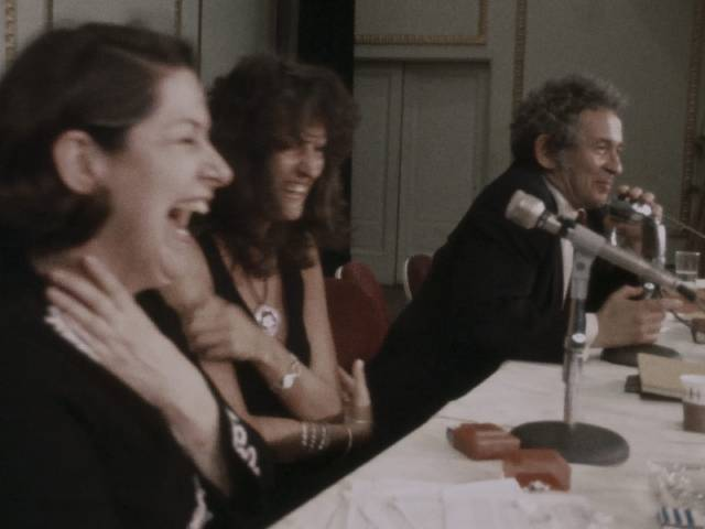 Jacqueline Cebellos and Germaine Greer enjoy an audience member's jab at Norman Mailer in Chris Hegedus and D.A. Pennebaker's Town Bloody Hall (1979)