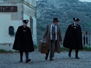 Painter Carlo Levi is escorted by police to exile in a remote village in Francesco Rosi's Christ Stopped at Eboli (1979)