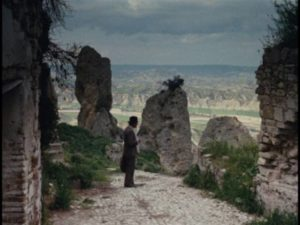 Carlo Levi (Gian Maria Volontè) pauses, waiting for his dog Barone to catch up with him in Francesco Rosi's Christ Stopped at Eboli (1979)