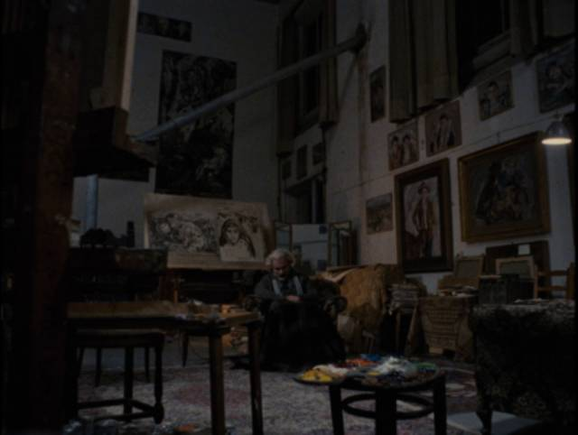 An older Carlo Levi (Gian Maria Volontè) sits among the paintings he made during his exile, remembering the people he lived among in Francesco Rosi's Christ Stopped at Eboli (1979)