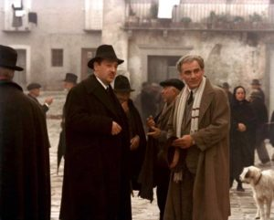 Carlo Levi (Gian Maria Volontè) greeted by the Fascist mayor (Paolo Bonacelli) in Francesco Rosi's Christ Stopped at Eboli (1979)