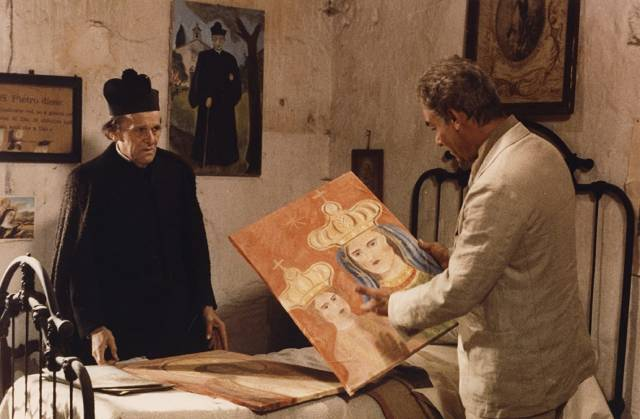 The exiled priest (François Simon) shows Carlo Levi (Gian Maria Volontè) his own paintings in Francesco Rosi's Christ Stopped at Eboli (1979)
