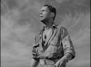 Corporal John Bramble (Franchot Tone) stranded in the desert after a battle in Billy Wilder's Five Graves to Cairo (1943)