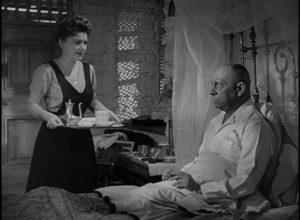 Mouche (Anne Baxter) attempts to seduce Field Marshall Erwin Rommel (Erich von Stroheim) in Billy Wilder's Five Graves to Cairo (1943)
