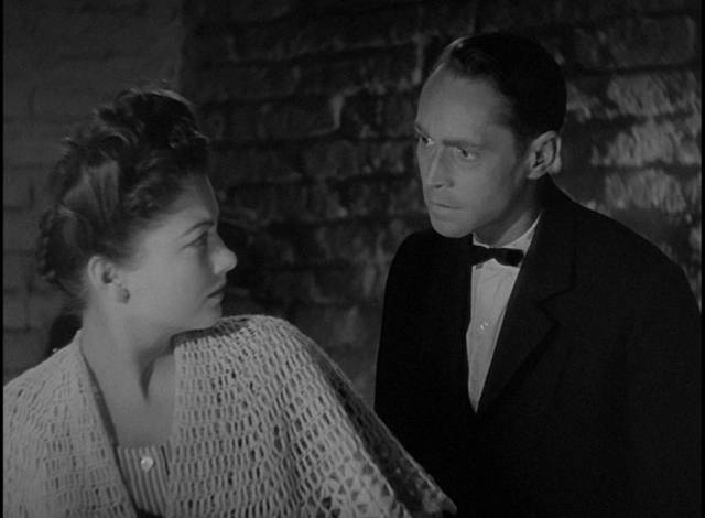 Mouche (Anne Baxter) is reluctant to help Cpl. John Bramble (Franchot Tone) in Billy Wilder's Five Graves to Cairo (1943)