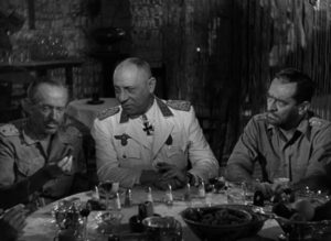 Field Marshall Erwin Rommel entertains captured British officers in Billy Wilder's Five Graves to Cairo (1943)