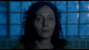 Kathy's mother (Dusica Zegarac) may or may not know something about what's going on in Lucio Fulci's Aenigma (1987)