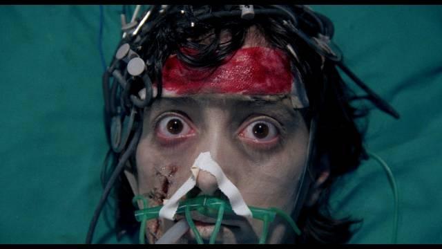 Kathy (Milijana Zirojevic) wreaks havoc from a coma in Lucio Fulci's Aenigma (1987)