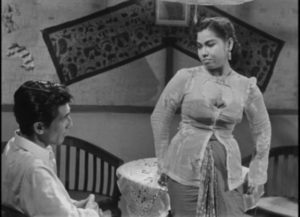 Prostitute Laila (Dhalia) believes Iskandar (A.N. Alcaff) represents a better life in Usmar Ismail's After the Curfew (1954)