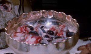Unappetizing buffet in Lucio Fulci's Cat in the Brain (1990)