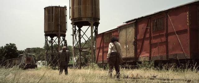 Candy (Daniel Tadesse) encounters enigmatic figures in an apocalyptic landscape in Miguel Llanso's Crumbs (2015)