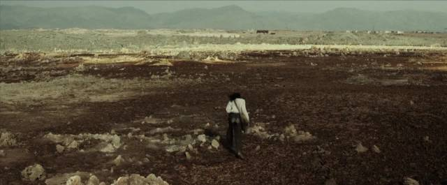Candy (Daniel Tadesse) scours the wasteland for pre-war artefacts in Miguel Llanso's Crumbs (2015)