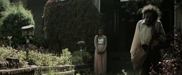 Candy (Daniel Tadesse) departs on his quest to seek information from the Witch (Shitaye Abraha) in Miguel Llanso's Crumbs (2015)