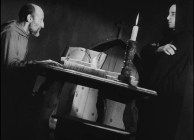 The Prior (Beltran De Heredia) enlists Juan (Victor Urruchua) to exorcise a troubled monk in Juan Bustillo Oro's Dos Monjes (1934)