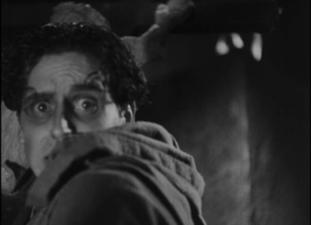 Javier (Carlos Villatoro)'s madness increases with the arrival of Juan (Victor Urruchua) in Juan Bustillo Oro's Dos Monjes (1934)