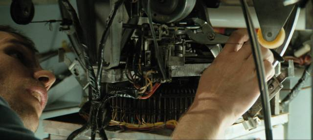 Repairman Mark Newman (James Marshall) looks for the fault in Dick Maas' Down (2001)